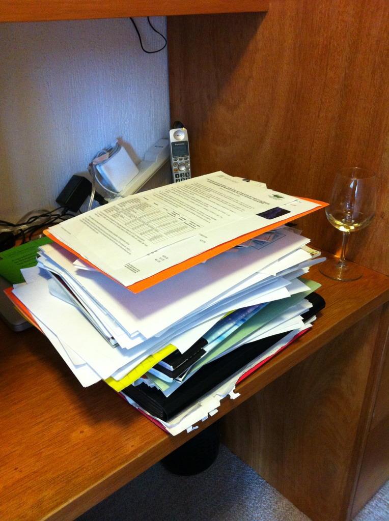 image from Pile still left to process in my year-start GTD review. Trying to start the yr with a clean slate/desk. The wine helps